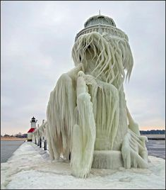 Frozen Lighthouse - Does it not look like a woman with her head on the back of her hand?