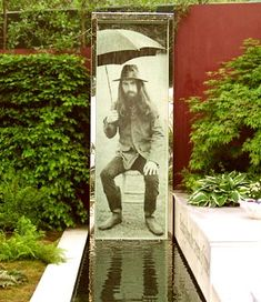 David Harber designed a special water wall with a life size photograph of George Harrison for the former Beatle's memorial garden, From Life To Life, A Garden for George, at RHS Chelsea 2008