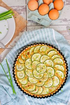 A dairy free twist on the French classic, Quiche Lorraine, made with bits of bacon, chopped chives, sliced zucchini, and a blend of herbs.