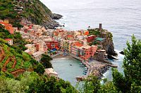 Hiking between colorful small towns of Cinque Terre , along steep, beautiful grape orchard lined trails.  Down there on the peninsula, we ate lunch. Lucky me.