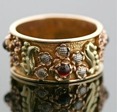 Amazingly Intricate: Arts and Crafts Era Band with Garnets and yellow, white and rose gold. Description from pinterest.com. I searched for this on bing.com/images