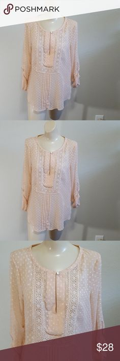 "Daniel Rainn Sheer Tunic Blouse Dotted Swiss Sz S Daniel Rainn Features: Sheer Blouse, Peasant, Tunic, Peach, Dotted Swiss, pleats in front, Hi Lo shirttail hem Crocheted Lace front & back, long sleeves with roll up tabs Tag Size: S Approximate measurements: Bust: 18"" across laying flat  Length: 27"" shoulder to bottom hem  Sleeve length: 18"" underarm to hem of cuff  fabric: 100% Polyester Color & Print: Peach Dotted Swiss Good pre-owned condition - Looks to have been worn very little Thank…"