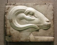 Relief plaque with ram's head from a god's figure,Ptolemaic period 400-300 BC