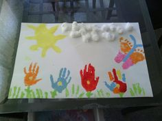 Summer Craft using hand and feet!! Use your toddler or babies hand prints to make the flowers use their fingers tomake grass and their feet to make a butter fly then simply have then glue cotton balls as the clouds!