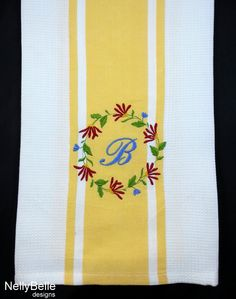 Floral monogram embroidered on cotton striped towel. A perfect hostess or bridal gift. NellyBelle Designs