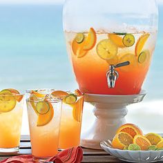 Seaside Sunrise Punch: Ingredients:  2 cups  pineapple juice,  2 cups  orange-mango juice,  2 cups  passion fruit –flavored rum,   1 cup  cranberry juice cocktail , 2 tablespoons  grenadine, 1   (750-milliliter) bottle sparkling wine,     Garnishes: orange and lime slices