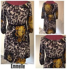 Emmelee Size ~ large Material ~ 75% polyester, 20% rayon, 5% spandex  Shoulders ~ 15 Arm ~ 14 Chest ~ 15 Waist ~ 13 elastic  Hips ~ 19 Length ~ 34 Pockets ~ 2 Multicolored  Flowers Elastic at neck & sleeves $25