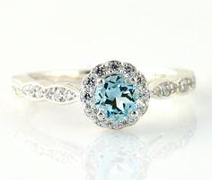 So beautiful! Love the unconventional color.  14K Aquamarine Engagement Ring Aquamarine Ring Diamond Halo 14K 18K Platinum Palladium Custom Bridal Jewelry. $925.00, via Etsy. This is breath taking!