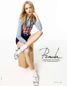 Camilla Christensen wears Prada top, shirt, shorts and heels