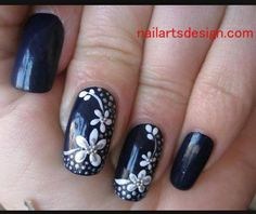 Dark blue with white flowers nails.