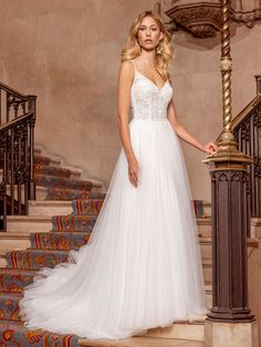 Our stunning A-Line wedding dress has combination of soft tulle and Chantilly lace with beaded appliqués on the bodice. For a bride writing her own modern princess fairy-tale. Find a stockist near you and request an appointment. Bridal Wedding Dresses, Bridal Outfits, Designer Wedding Dresses, Bridesmaid Dresses, Ellis Bridal, Fit N Flare Dress, Perfect Wedding Dress, Lace Bodice, Ball Gowns