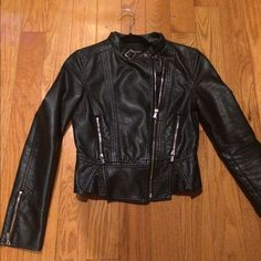 Express faux leather jacket Worn. Black leather . Great motorcycle leather jacket with a little peplum on bottom. Worn out inside sleeves and silver hardware on zipper pulls a bit tarnished. Express Jackets & Coats