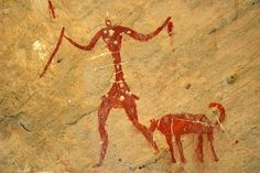 Cave painting of man and dog