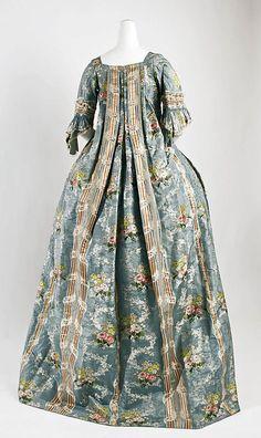 Robe à la Française, Italy, 1765-1770. Brocaded blue silk with polychrome flower sprays.