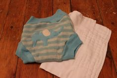 Prepping cloth diapers, explained. Separate synthetics from natural fibers, etc.