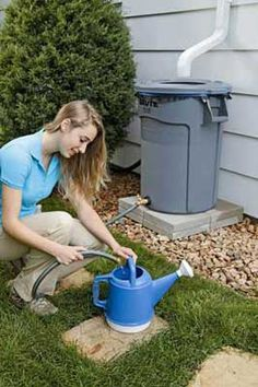 Homemade Rain Barrel - good way to 'recycle' water and not have to jack up your water bill!