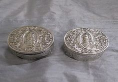 A Matched Pair of Hanau Oval Silver Boxes depicting King George