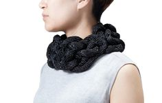 Michigan-based artist Yuni Kim Lang creates modern jewelry out of ordinary black rope that was inspired by Korean and Chinese cultural references, like the Button Knot. The bold pieces are made from an industrial polyproylene rope that is formed into knotted wearable sculptures that make you forget what they're made of.