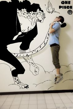 Gaikuo-Captain is a Chinese student in chemical engineering but it is also a talented illustrator and a comic books and mangas lover. He has created giant illustrations with which he confronts and interacts, facing heroes such as Batman, Hulk or characters from the world of One Piece manga or video games like Pokemon.