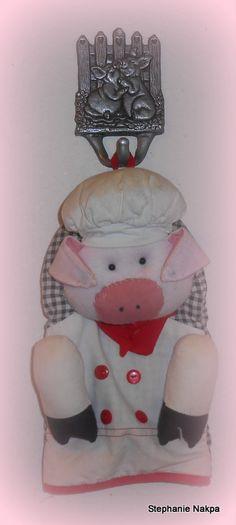 A pig hook and pig oven mitt.