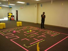 interactive pacman board game for arcade party, using graft tape on carpet so that it will not damage carpet. made the ghost out of giant easter egg, trun oven to 240 heat the egg for 2 mins take it out to cut the shape, it helps to soften the plastic, made by Veronica