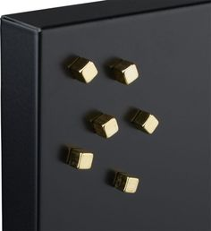 Shop small gold magnets.   Six gold cubes make a minimalist statement with maximal magnetism, clinging multiple notes, hefty mail, photos and holiday cards to the fridge or magnetic board.