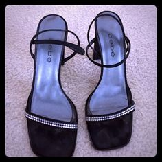 BeBe Sandals w/Rhinestone Strap Bebe Black Sandals with rhinestone strap going across foot. Shoes have a double elastic strap around ankle. Have a 3 inch square material heel. bebe Shoes Sandals