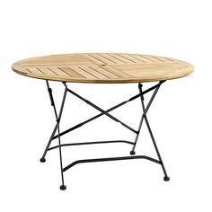 """Giardino 48"""" Round Teak Folding Dining Table $599.00 ballarddesigns.com  Frames are crafted of rust-resistant, powder-coated iron and fitted with thick slats of naturally weather-resistant and insect-resistant teak. If left untreated, teak finish will develop into a warm silvery gray patina over time. Table accommodates a 2"""" diameter umbrella. Includes matching cap for the umbrella opening."""