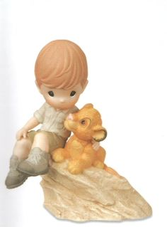 $50.00  Precious Moments You're My Pride And Joy  Features a little boy with Simba from The Lion King. Figurine is made of porcelain. The Precious Moments Disney Collection brings your favorite Disney characters to life. Shopping, Gifts, Home Decor. CLICK IMAGE TO BUY NOW