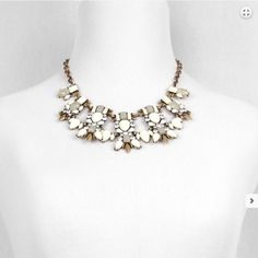 """NWT Statement necklace NWT Retail. Complete your outfit with this elegant burnished gold necklace. Burnished gold metal necklace with 7 rhinestone pendants with ivory and taupe colored stones. Make a statement wearing this today!   Size + Fit: Length: 20"""" Décor width: 1"""" Décor length: 1"""" - 1.5""""   Features: Nickel free Lead free Jewelry Necklaces"""