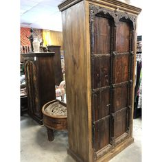 Antique Indian Furniture Spanish Colonial Dark Teak Wood Storage Wardrobe The Antique armoire comes from India and with age the doors have patina-ed beautifullySpecial Rusti Antique Furniture For Sale, Indian Furniture, Custom Wood Doors, Rustic Doors, Barn Doors, Industrial Furniture, Rustic Furniture, Kitchen Furniture, Outdoor Furniture