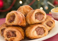 1 tube (8 ounces) refrigerated crescent rolls 24 miniature smoked sausage links 1/2 cup butter, melted 1/2 cup chopped nuts 3 tablespoons honey 3 tables...