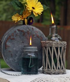 Old mason jars and bottles made into oil lanterns. Use citronella and they're perfect for summers in Texas. <3