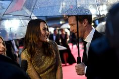 """Keira Knightley Photos Photos - Actor Benedict Cumberbatch and actress Keira Knightley talk to a reporter as they attend the opening night gala screening of """"The Imitation Game"""" during the 58th BFI London Film Festival at Odeon Leicester Square on October 8, 2014 in London, England. - 'The Imitation Game' Screening in London"""