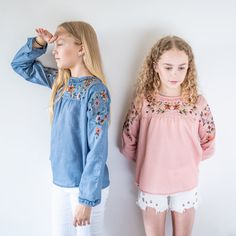 Cute smock long sleeve girls tops in pink and denim blue. Embroidered floral top looks great with shorts or jeans. Creative Kids, Stylish Dresses, Cool T Shirts, Blue Denim, Looks Great, Floral Tops, Kids Fashion, Girl Outfits, Shorts