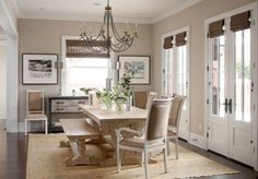 trestle table with bench on dark floor + cream colored rug = overall bright appearance. I like!