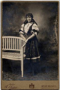 Girl in traditional costume of Moravia. Photographer Rudolf Skopec in Velké Meziříčí (Moravia, Czechia). Cabinet card circa 1910.