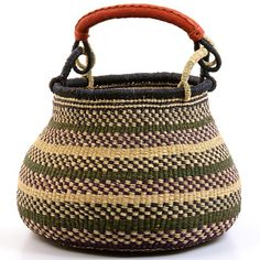 Coming from Gambibgo village, in the Bolgatanga region of Ghana, these baskets are often used to store things in the home. This Gambibgo basket is unusual in that is has a swivel handle that folds down flat. Also, the appealing bulbous shape is more difficult to weave than a normal round basket. Weavers in the region use the abundant Veta vera grass to weave these incredibly hardy, useful baskets