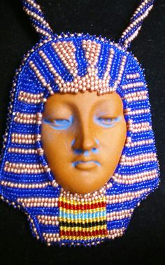 Queen Tut.  Using a Diane Briegleg ceramic face, I bead embroidered around it to look like the Egyptian King's mask.