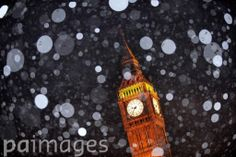 Snow falls in Parliament Square, London, as a cold snap hits Britain.