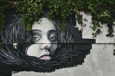 Woman on the Wall. Modern Street Art