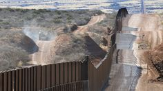 Military border patrol US-Mexico Wall in desert