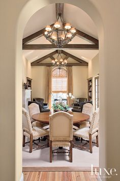 Mediterranean Cream Dining Room with Western-Style Chandeliers
