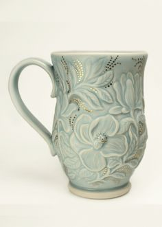 Grace DePledge Pottery makes intricately carved, porcelain pottery to celebrate and enhance the simple joy of everyday life.