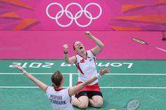 Christinna Pedersen and Kamilla Rytter Juhl of Denmark celebrate a victory in their women's doubles Badminton match.