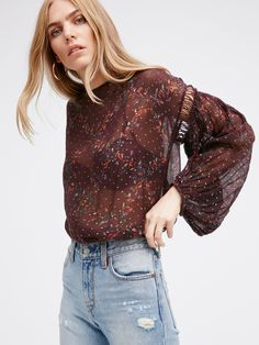 Fabienne Printed Peasant Top | Long sleeve peasant style top featuring a lightweight, sheer fabrication. Femme floral print with subtle metallic accents throughout. Crochet details on the puffy sleeve. Adjustable drawstring at the trim and elastic at the cuffs for an easy fit.