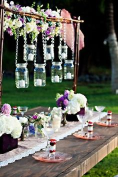 Don't have a way to suspend hanging decorations?  Consider doing something like these mason jars. #HangingDecorations #Wedding #TableDecorations