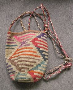 This bag is called a shigra and is knotted from a cactus fiber called cabuya. This bag was made in central Ecuador by a Kichwa woman.