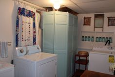 Make over for basement Laundry room- curtains on PCV pipe with round hooks. Also like the old closet doors used to cover up the water heater.