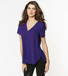 Look gorgeous in this purple v-neck tunic!